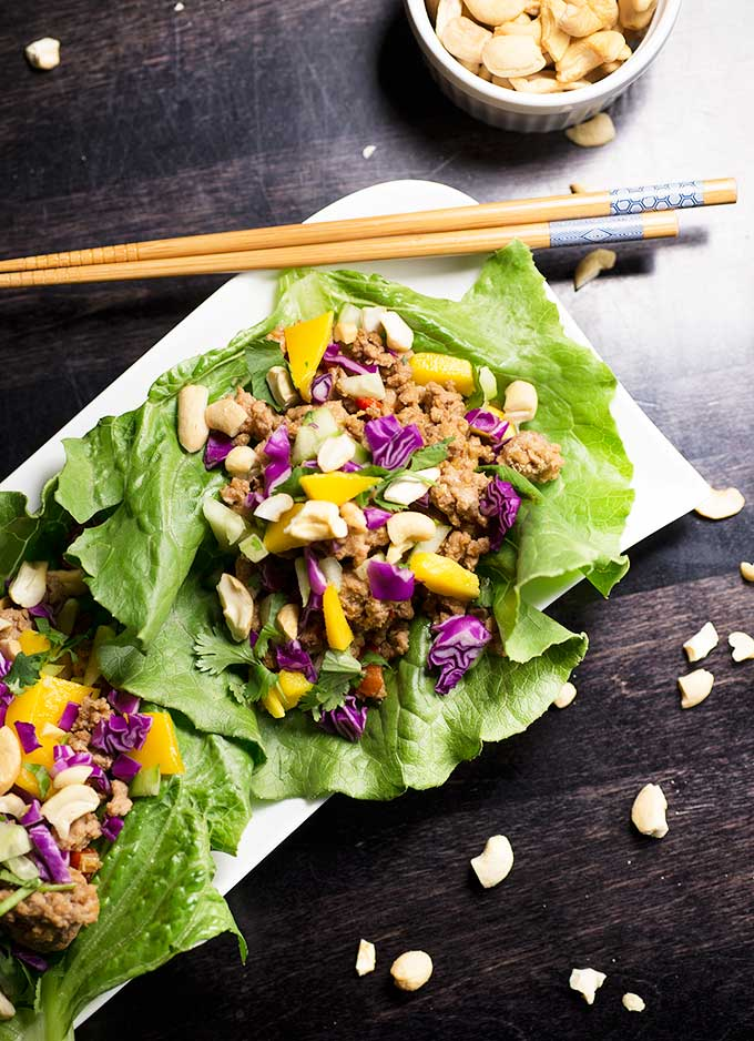 Wrap dinner up with these one-pot Cashew Chicken Lettuce Wraps...Leafy green lettuce filled with honey-soy chicken, mangos, sweet peppers and cashews!