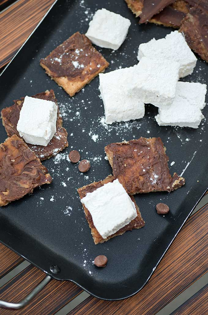 Chocolate Caramel S'mores - homemade marshmallows and gooey chocolate-caramel graham crackers are the perfect treat that'll leave you wanting s'more!