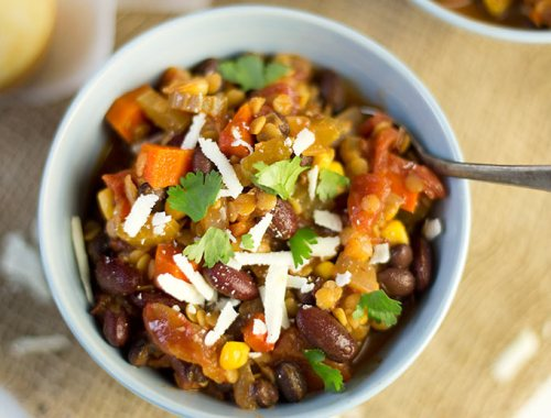 Boost your energy with hearty Vegetarian Lentil Chili! Packed with carrots, celery, beans, lentils and spicy chipotles...you won't even miss the meat!