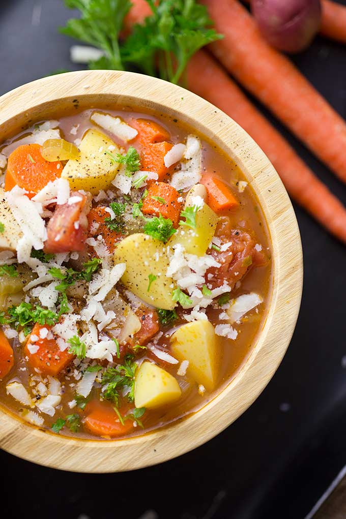 Tuscan Vegetable Soup is a one-pot wonder: tomatoes, carrots, cabbage, lots of nutritious, delicious veggies, topped with basil and melty Italian cheese!