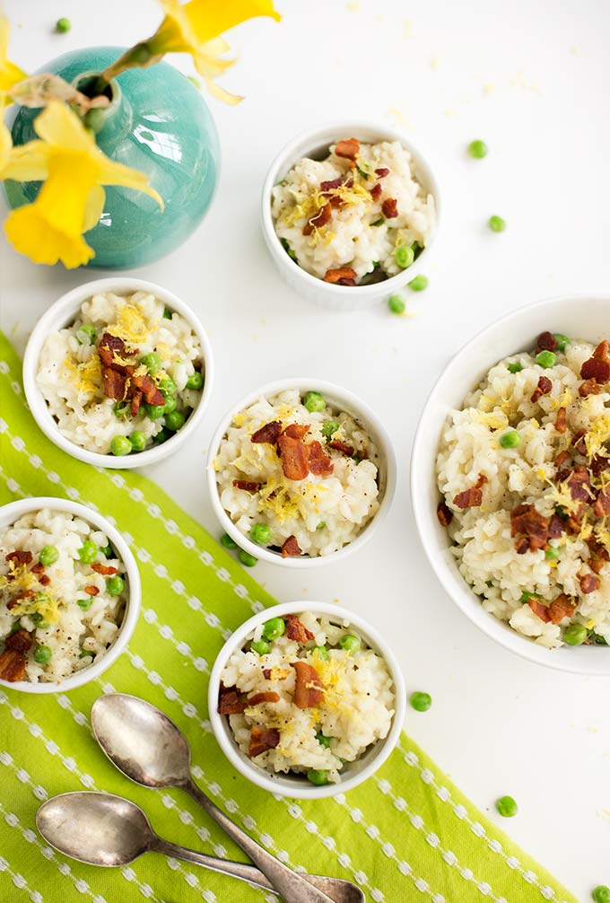 This Spring Pea Risotto recipe combines creamy arborio rice with peas, lemon zest and a touch of crispy bacon. Dinner on the table in 35 minutes!