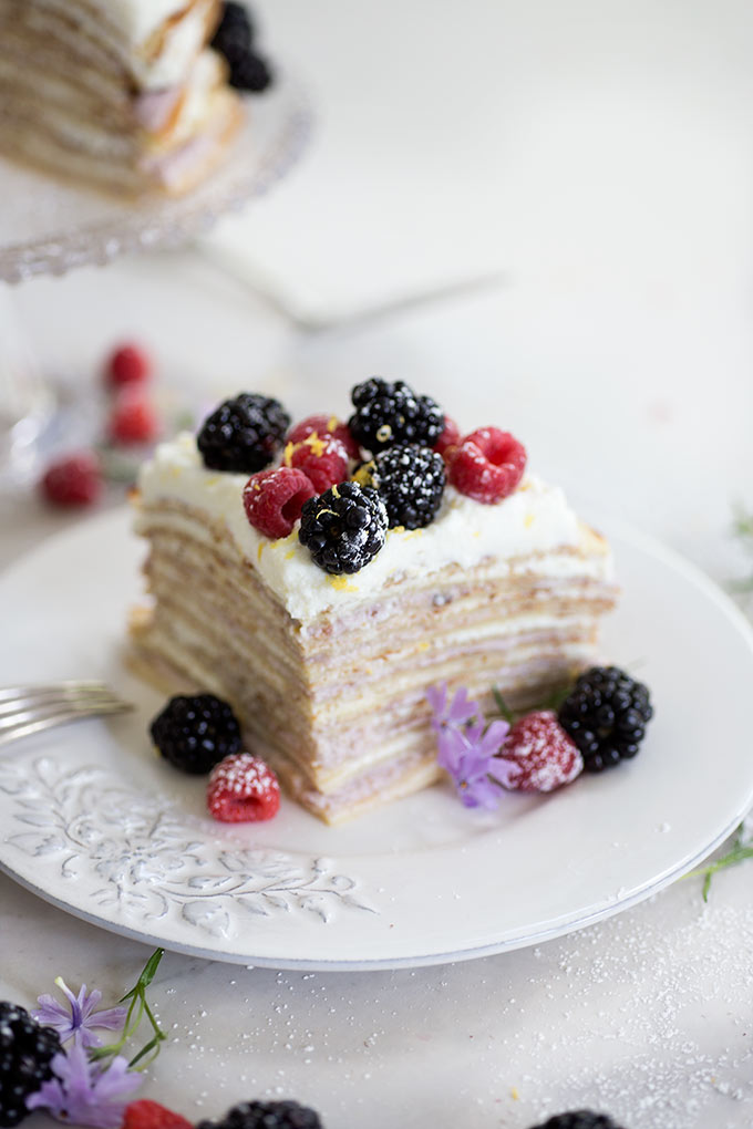 Step-by-step Breakfast Crepe Cake - a simple breakdown of how to make a perfect breakfast crepe cake! Raspberry and lemon ricotta between layers of crepes!
