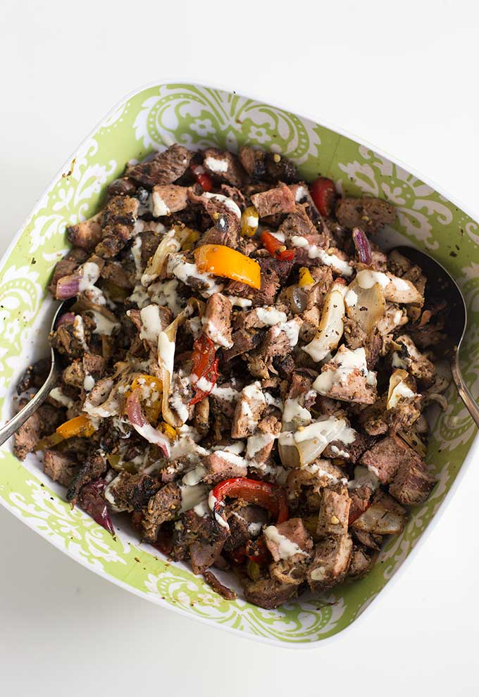 """Real Man's Greenless Meat Salad - a heaping pile of marinated meat, drizzled with a creamy vinaigrette. This greenless """"salad"""" won't disappoint."""