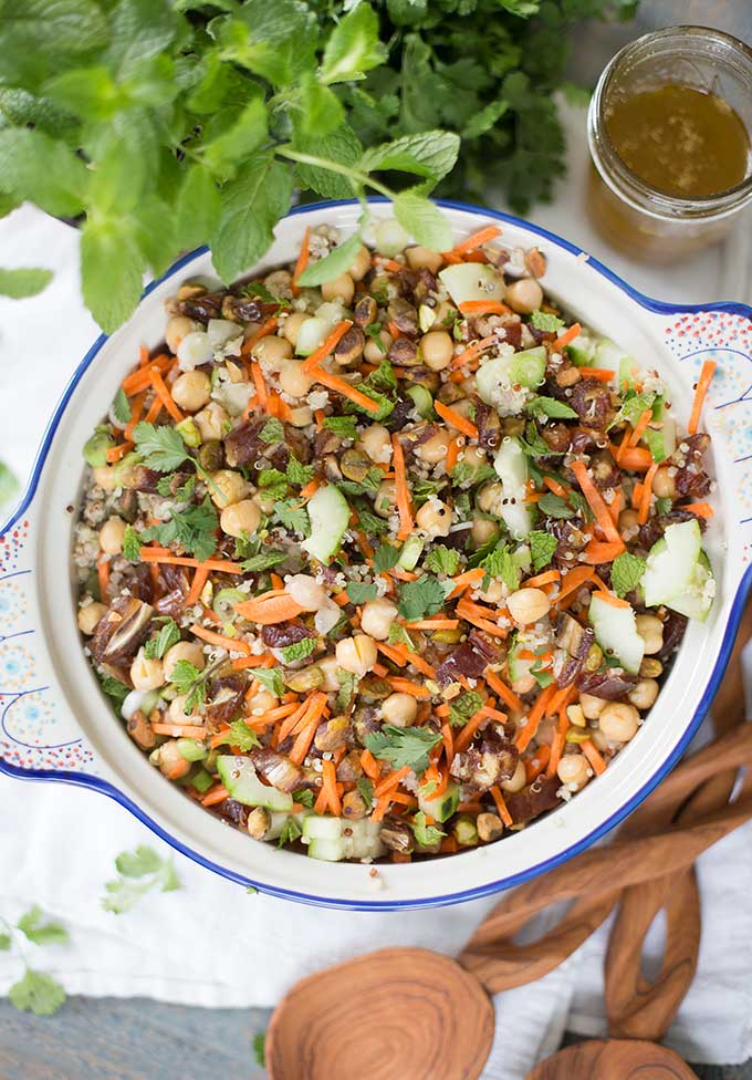 Moroccan Chickpea Salad - a bright, refreshing mix of quinoa, chickpeas, cucumbers, dates, pistachios and fresh mint. Tossed with a lemony vinaigrette!