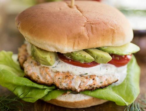 Salmon Burgers with Lemon-Dill Sauce - fresh salmon fillets mixed with capers, lemon and mustard. Served on toasted buns with a creamy Lemon-Dill Sauce!