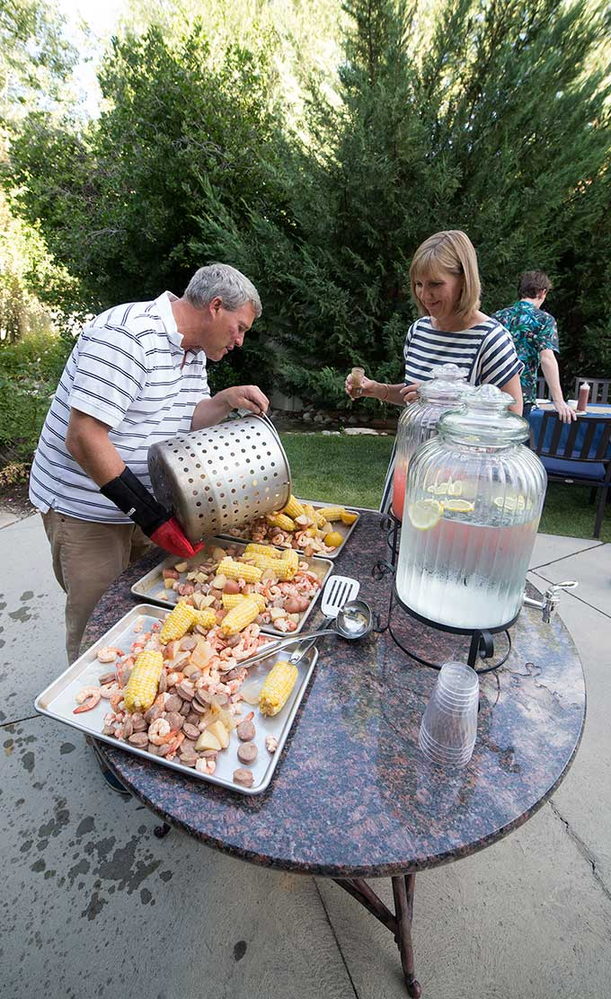 Low Country Boil: potatoes, fresh corn, sausage, lobster and shrimp, all thrown into a huge pot and cooked to succulent goodness! The ultimate family feast!