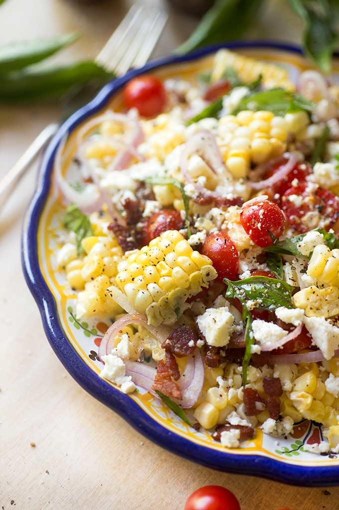Fresh Corn-off-the-Cob Salad - crunchy jicama, bacon bits, mint and garden tomatoes come together with fresh corn in a simple but delicious salad.