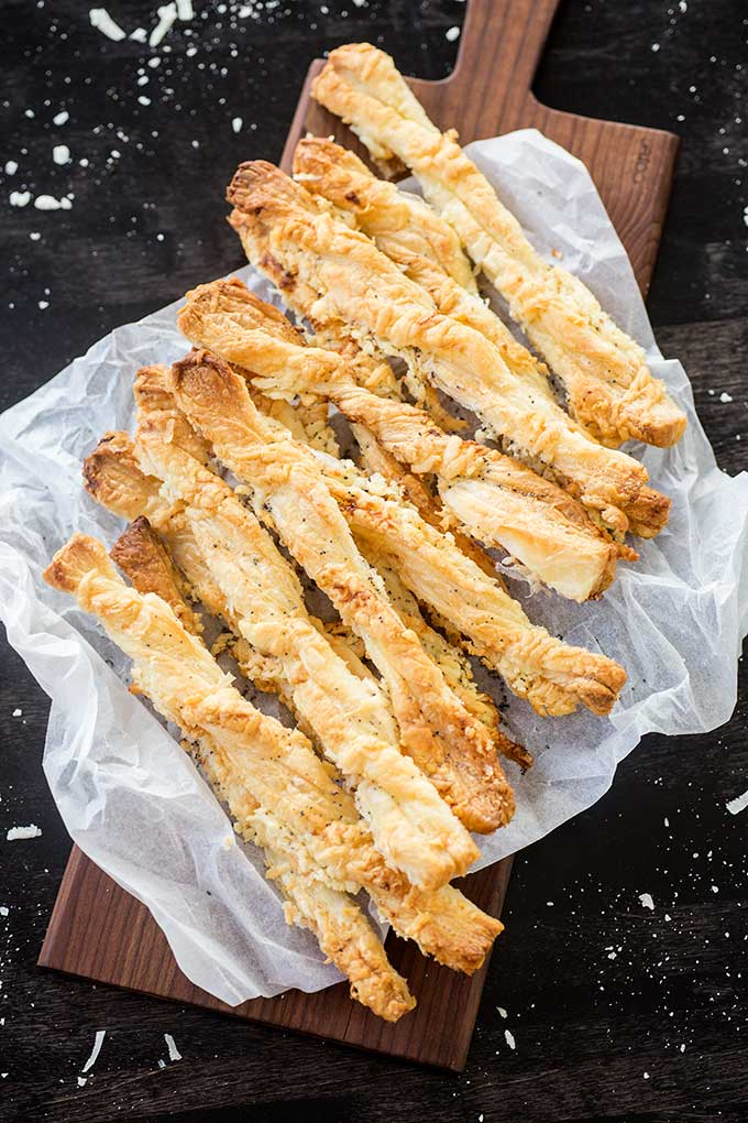 Best Breadsticks Ever: puff pastry, a little butter and cheese are all you need to make these amazing, flaky, light breadsticks!