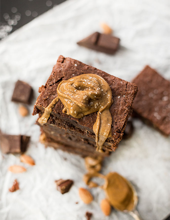 Flourless Freezer Brownies - rich, decadent brownies, completely gluten and grain-free! Made from almond flour and natural sweeteners, these brownies are a delicious treat you can feel good about eating! Eat right out of the pan or freeze and eat straight from the freezer!