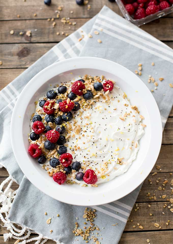 Greek Yogurt Parfait Bowl - creamy vanilla yogurt topped with lemon zest, fresh berries and crunchy homemade granola. This is an easy and versatile breakfast or snack, full of protein and so yummy!