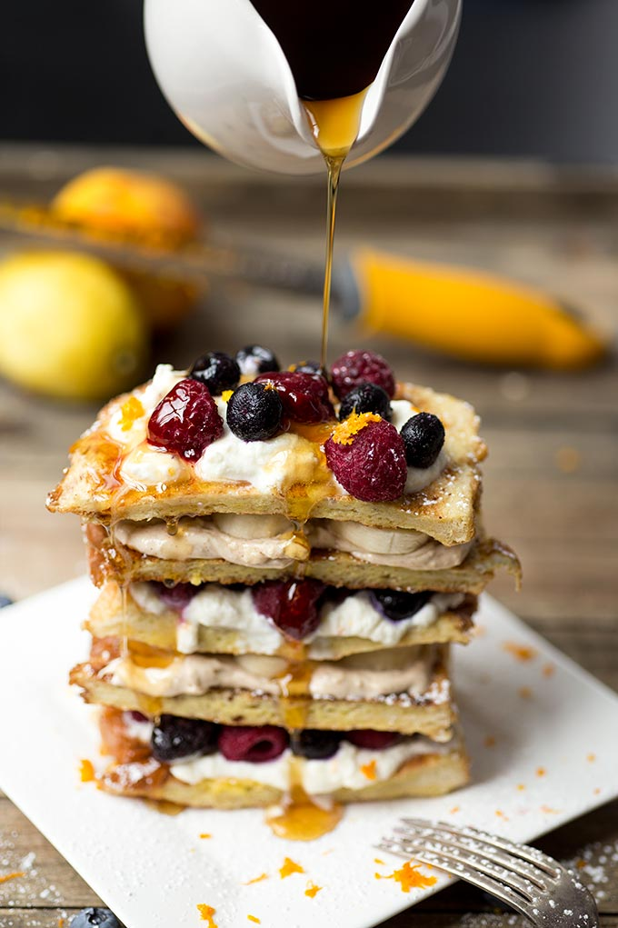 Stuffed French Toast is a quick and easy breakfast that satisfies any sweet tooth! Layers of French Toast piled high with cream cheese filling and fresh fruit.