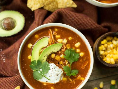 Adobo Chicken Tortilla Soup - this recipe uses fresh tomatoes, onions, cilantro and chipotle peppers to create a flavorful chicken tortilla soup with a kick!