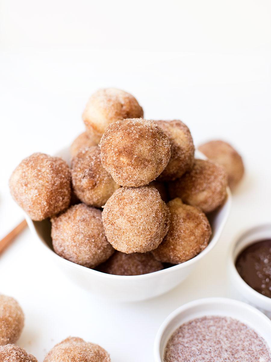 Baked Churro Poppers - a fluffy churro batter baked in the oven and sprinkled with cinnamon and sugar. Dip them in a Mexican chocolate sauce or maple vanilla sauce for an extra delicious treat!