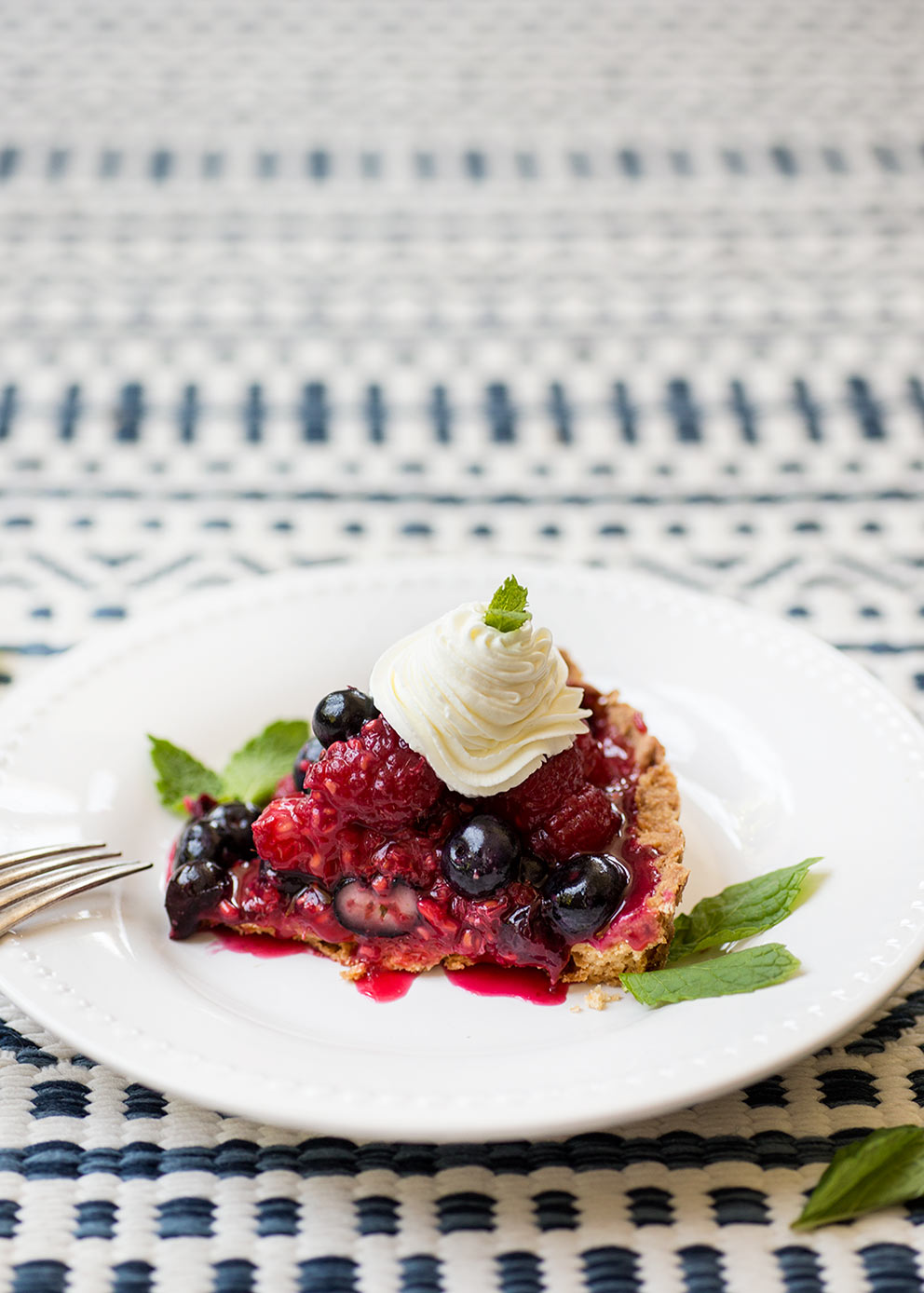 Raspberry Blueberry Tart: Raspberries, blueberries and whipped cream piled high in a shortbread cookie crust...the perfect red, white and blue dessert!