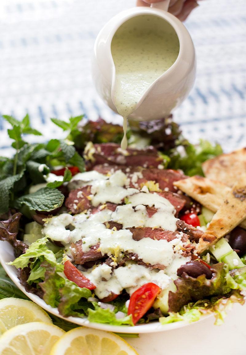 Greek Gyro Salad: Marinated, grilled lamb, garden-fresh veggies, fresh feta cheese and grilled pitas, topped with homemade fresh tzatziki dressing.