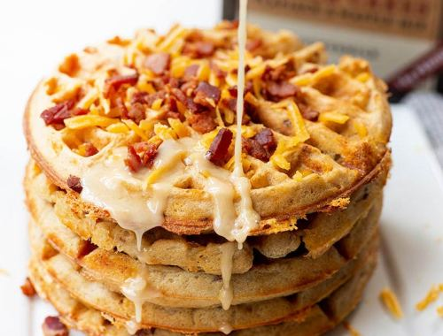 Bacon Cheddar Waffle with Maple Glaze - fluffy waffles cooked to crispy perfection, packed full of savory bacon and chees and drizzled with a maple glaze.
