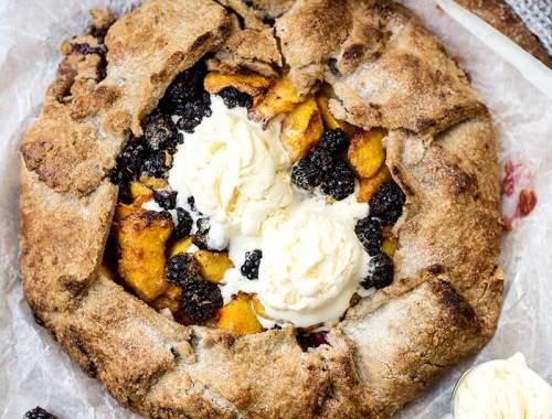 Blackberry Peach Galette: A freeform buttery pie crust piled high with cinnamon and sugar-laced fresh blackberries and peaches.