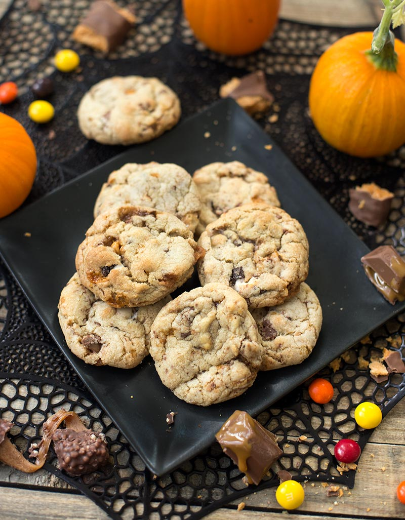 Halloween Candy Cookies are made with chopped up pieces of candy...a caramelly, chocolately, ooey, gooey mess of goodness. A fun way to use up extra candy!