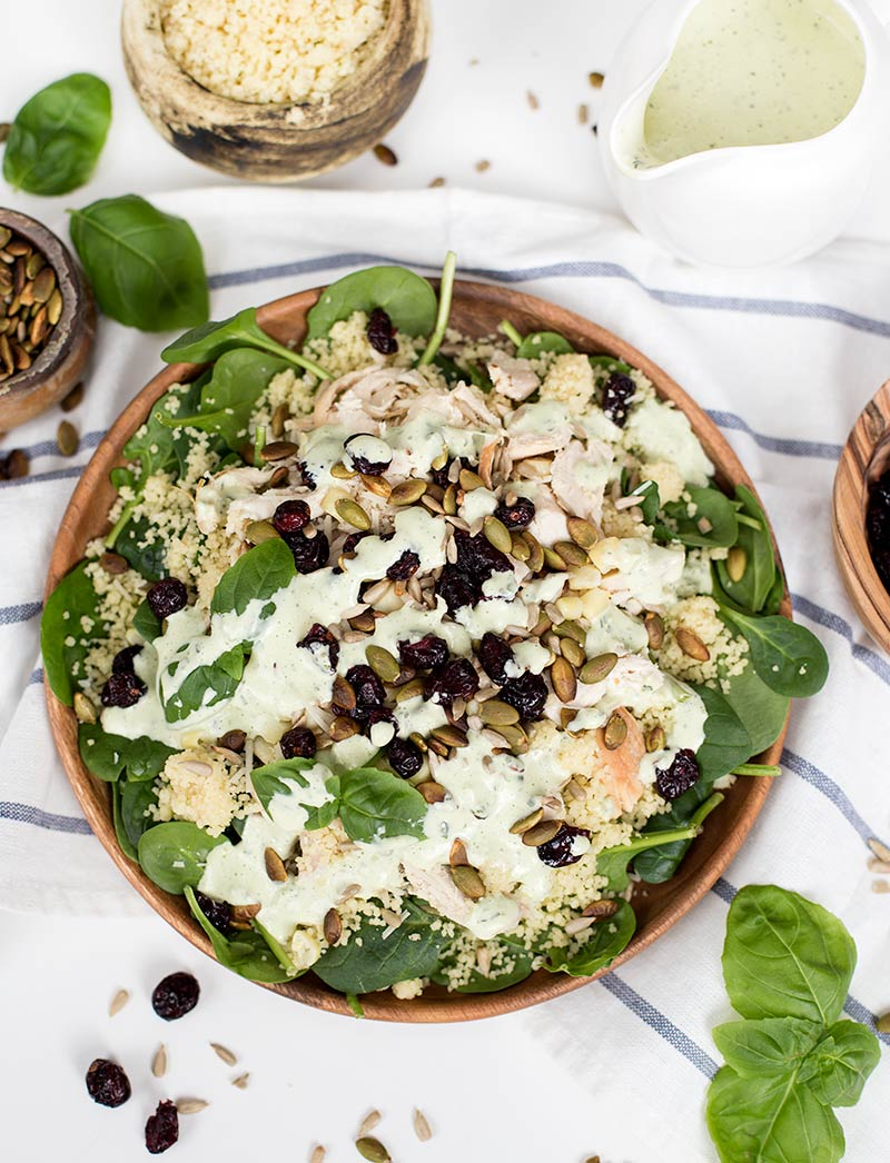 Chicken Couscous Salad with Basil Dressing: A quick and easy spinach salad with chicken, craisins, pumpkin seeds and a fresh basil dressing!