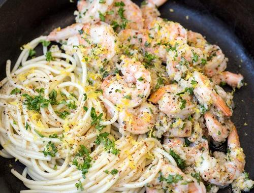 Quick and Easy Shrimp Scampi: Shrimp cooked in garlic, lemon and butter, and served over fresh pasta for a super fast, easy, elegant dinner!
