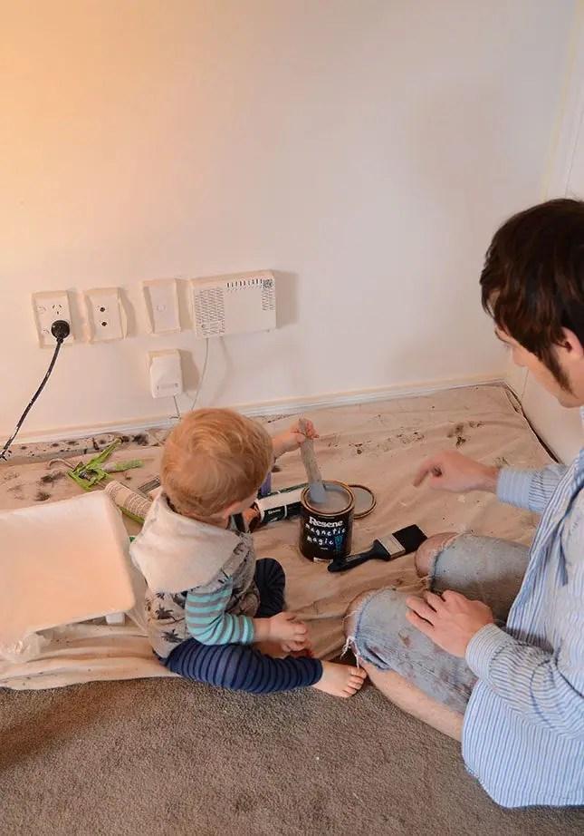 Under-stairs-kids-study-nook-paint-stirring