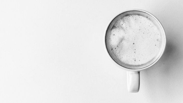cup of coffee on white surface image.