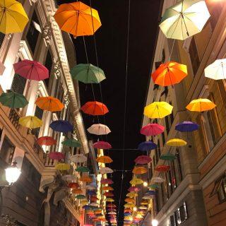 Colored umbrellas hanging in Genoa in via XXV Aprile