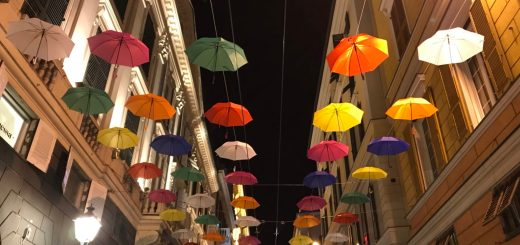 Colored umbrellas hanging in Genoa in via XXV Aprile