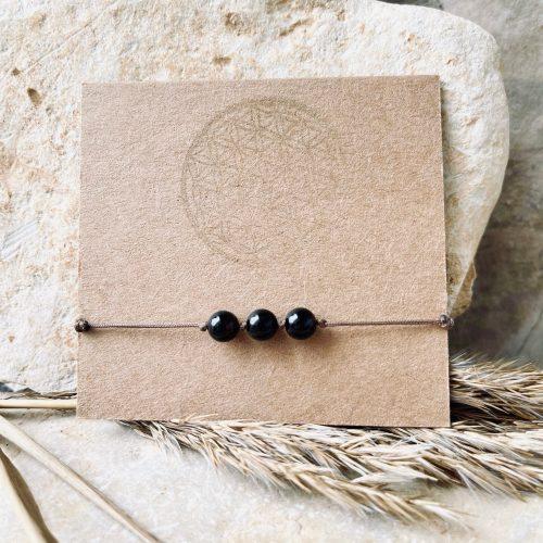 Karmaarmband aus schwarzem Achat