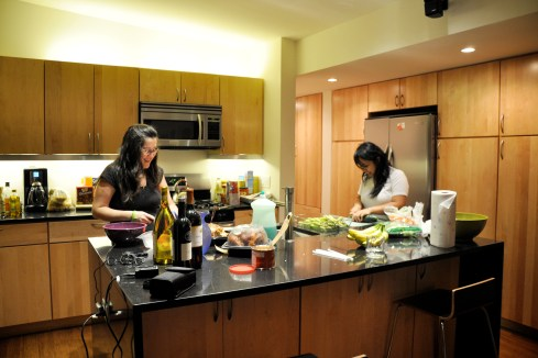 """Diana and Karell prepping dinner"" by David Trawin is licensed by CC By-SA 2.0"