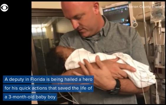 Cop saves baby _1527889295770.jpg.jpg