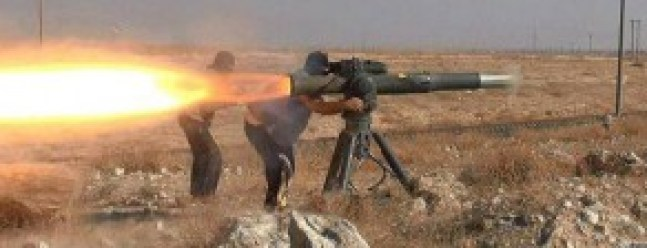 """In this picture released on June 26, 2015, by a website of Islamic State militants, Islamic State militants fire an anti-tank missile in Hassakeh, northeast Syria. Andreas Krieg, a professor at King's College London who embedded with Iraqi Kurdish fighters in the fall of 2014, says IS local commanders are given leeway to operate as they see fit. They """"have overall orders on strategy and are expected to come up with the most efficient ways of adapting it,"""" he said. (Militant website via AP)"""