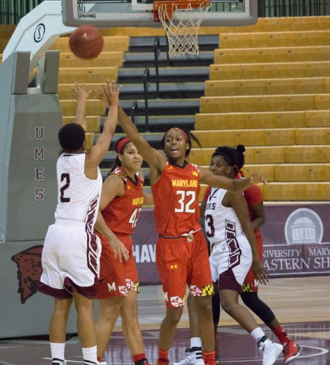 Shatori Walker-Kimbrough (32) flies out to successfully prevent a UMES basket. Shatori had a busy day with 23 points, six rebounds, a blocked shot, and three steals in just 28 minutes.