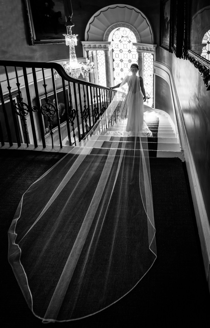 bride on the grand staircase at ripley castle