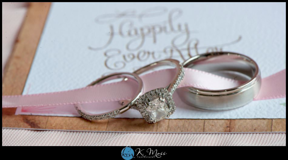 wedding rings tied in ribbon on invitations