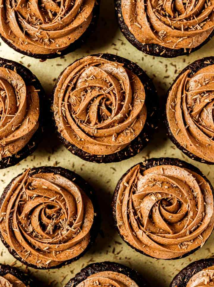cupcakes topped with chocolate frosting