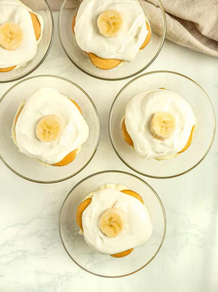 dessert topped with whipped cream and banana slices
