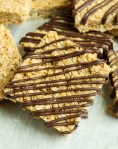 No-Bake Oat Bars topped with a drizzle of chocolate
