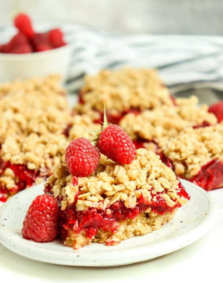berry oatmeal bars topped with raspberries