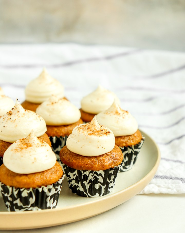 plate of frosted pumpkin cupcakes