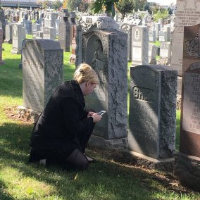 Chapter member recording information on headstone for Find A Grave
