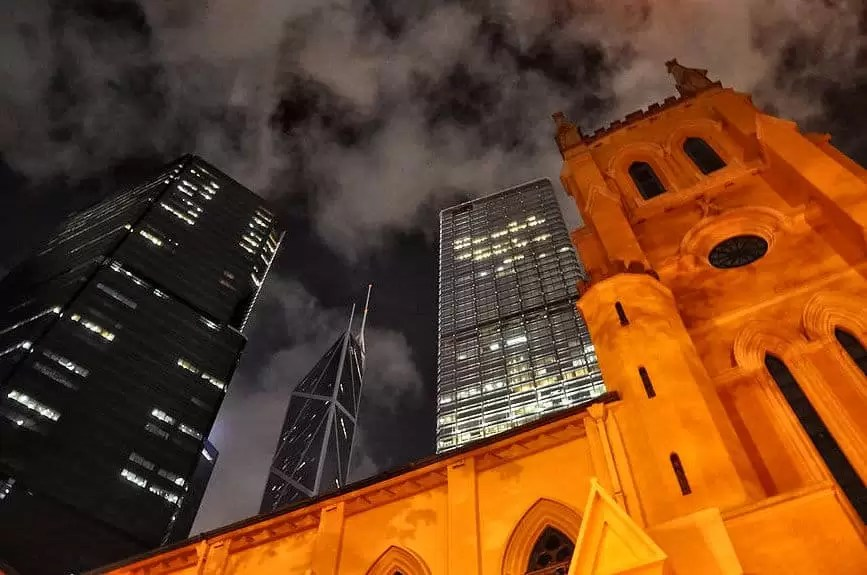 tall church and skyscrapers