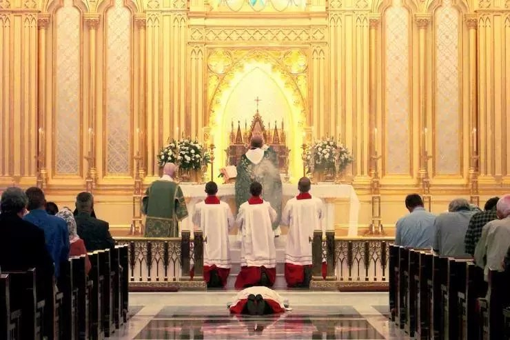 Knights adoring the Most Blessed Sacrament during the Consecration