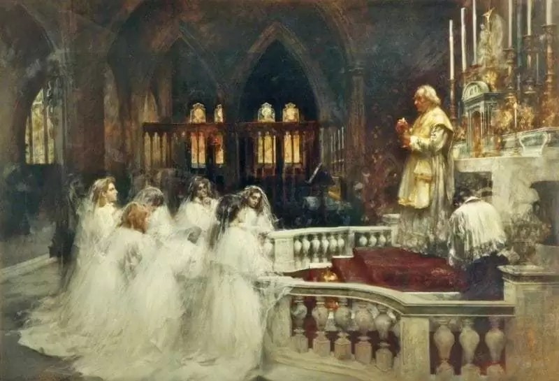 Priest elevating the Eucharist while girls in white and an altar boy adore