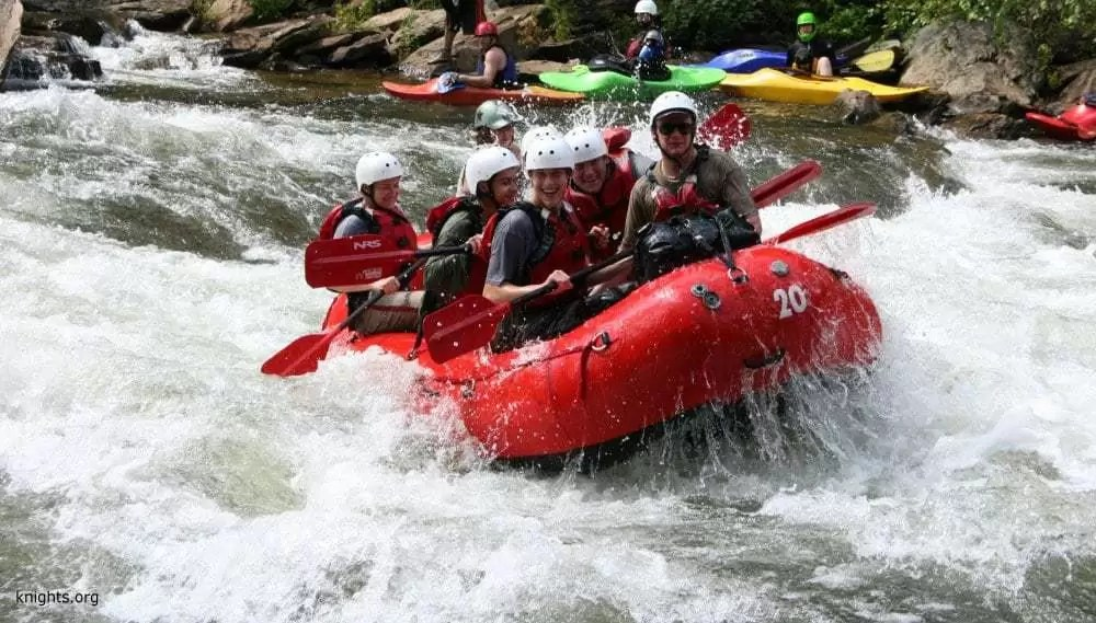 people recreating in a raft