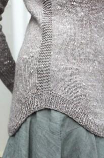 The curving hem and garter seam detail of Enso © Renée Callahan