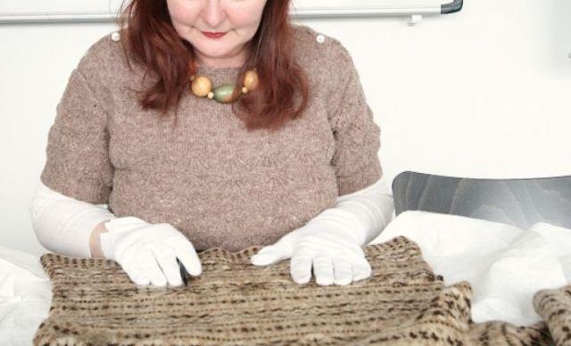 Susan studying knitwear in the Shetland Museum