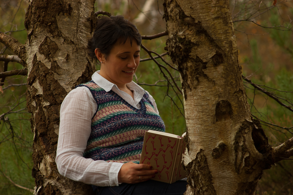 Judith reading one of the books whose cover design inspired her beauteous vest