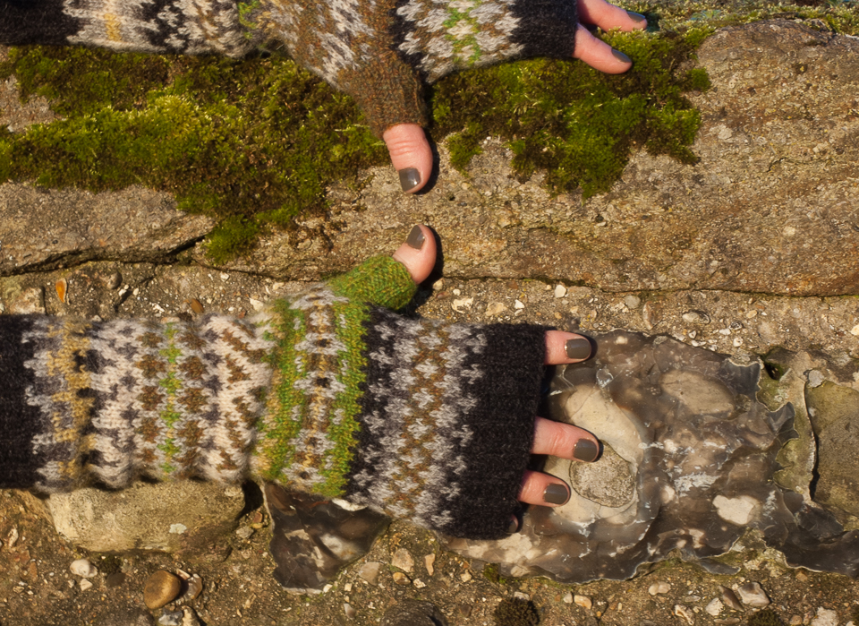 KNITSONIK Silchester Mitts photographed with ancient Roman wall