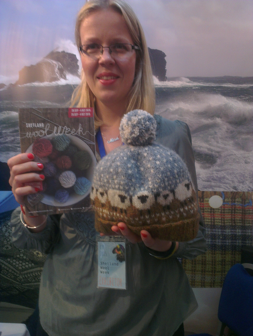 Misa Hay on the Shetland Wool Week stall with Donna Smith's Baa-ble hat design last year at EYF!